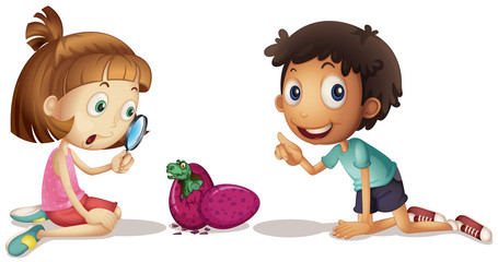 Two kids looking at baby dinosaur hatching egg