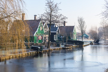 Beautiful green houses and frosted canal