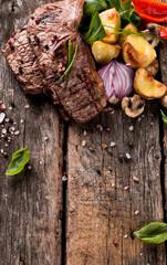 Beef steak on woode table, Fresh grilled steak with vegetable