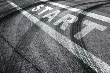 Race start line pattern background on the asphalt floor with crossing of tires tracks. Wall mural