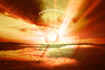 Dramatic red evening sky with illustrated radiation symbol. Conceptual nature landscape disaster background.