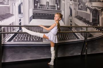 Little ballerina in a dance studio
