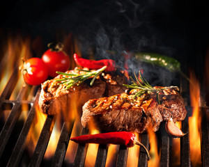 Acrylic Prints Grill / Barbecue Beef steaks on the grill