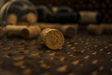 Corks from bottles of wine. On brown wooden background. Wine glass with corks