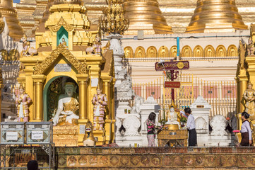 People praying at Shwedagon Pagoda in Yangon, Burma Myanmar