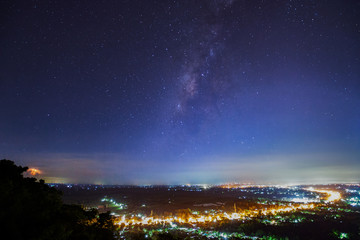 City landscape at nigh with Milky Way galaxy, Long exposure photograph.with grain