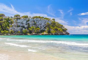 View on Mirador Sa Punta cliff from Cala Galdana beach at Menorca.
