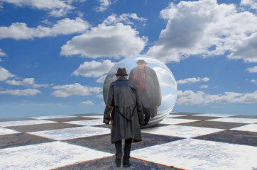 Man and sphere on chess board. Surreal concept