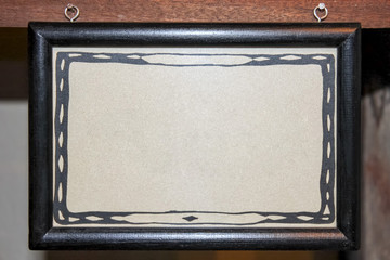 Black wooden frame with empty place for text in african art patterned paper