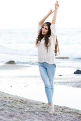 Woman with perfect hair near the beach