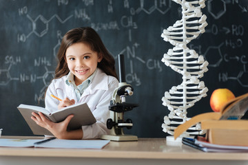 Smiling young researcher studying science in the laboratory