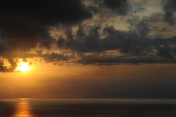 Off-centered sunset with dramatic dark clouds in Tenerife, Canary Islands