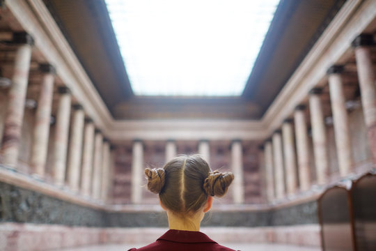 Back of head view of schoolgirl in museum