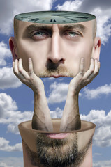 Surreal portrait of bearded man. Human head divided on two parts on clouds background