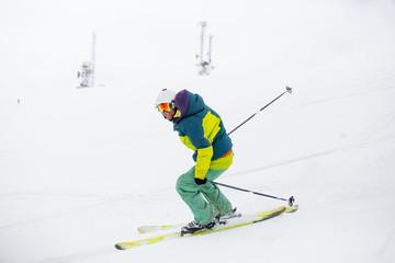 skier skiing on fresh snow on ski slope on Sunny winter day in the ski resort in Georgia