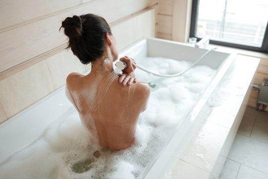 Brunette naked women in the bathtub Naked Brunette Woman Having A Shower In Bathtub Stock Photo Adobe Stock