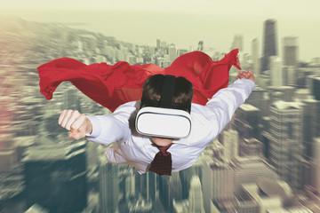 Businessman superhero wearing virtual reality glasses