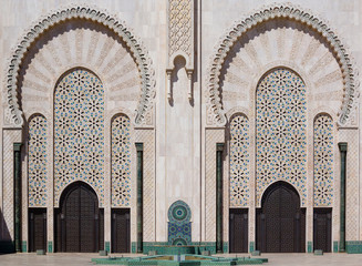 Two symmetrical  ornamental entrance to temple in Morocco.