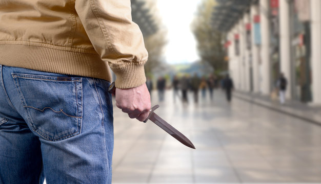 killer attacking with knife on public place