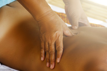 Woman during traditional Thai massage
