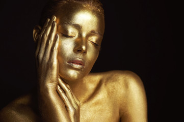 Portrait unearthly Golden girls, hands near the face. Very delicate and feminine. The eyes are closed