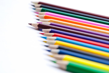 Photo of planed colored pencils on the light background
