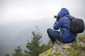 Nature photographer taking photos in the mountains.