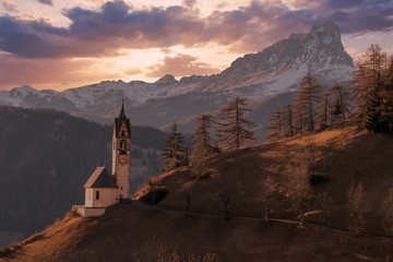 dolomites mountain church at sunset