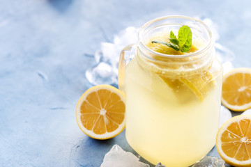 Fresh lemonade in mug jar with ice and mint