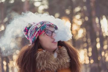 Electronic Cigarette. The girl smokes electronic cigarette.