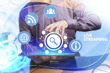 Business, Technology, Internet and network concept. Young businessman working on a virtual screen of the future and sees the inscription: Live streaming