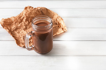 Natural detox chocolate smoothie on white background
