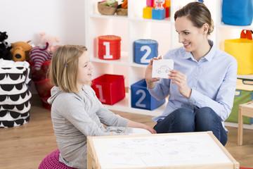 Girl visiting speech therapist