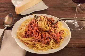 Plate of pasta with meat and tomato sauce