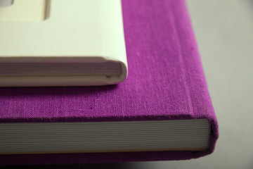 A fragment of a binding of photobooks