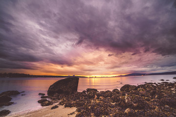 Rock balance with sunset sky backgrounds