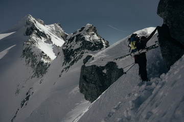 ski mountaineer climbing towards a ridge