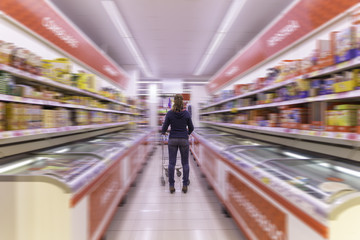 Woman buying in a supermarket