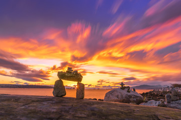 rocks balance on beach with sunset clouds sky backgrounds