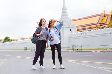Two girlfriends traveling to Grand- Palace in Bangkok,Thailand