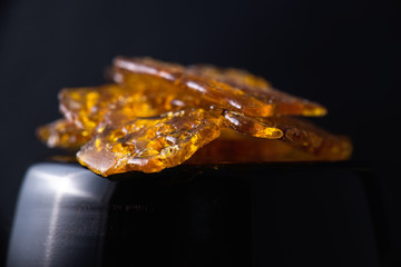 Marijuana oil concentrate aka shatter isolated on black background