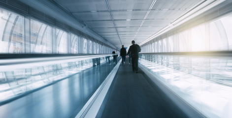 Blurred skywalk with Commuters
