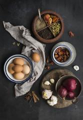 Still life of eggs, onions, herbs