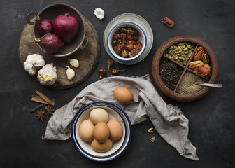 Still life of eggs, onions and herbs, close up