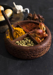 Assorted spices in wooden container