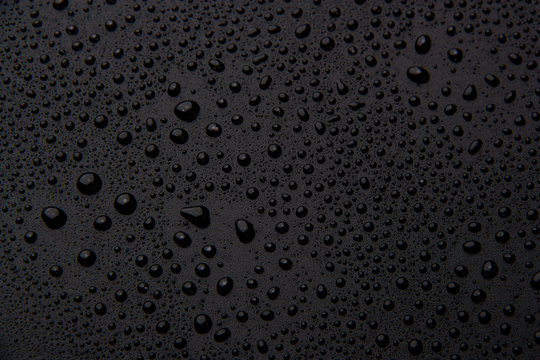 Drops of water on a black background.