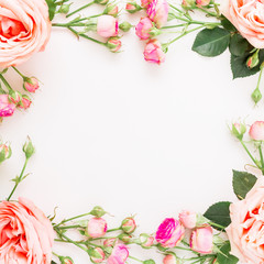 Floral square frame with pink roses isolated on white background. Flat lay, top view. Flowers background.