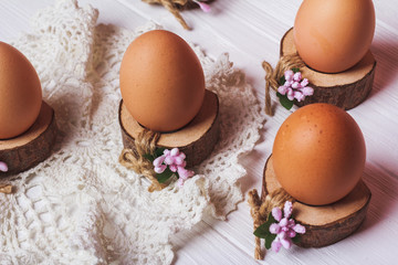 Easter background with eggs sitting in wood stand