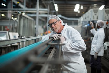 Factory engineer monitoring production line