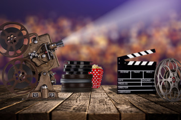 Cinema concept of vintage film reels, clapperboard and projector.